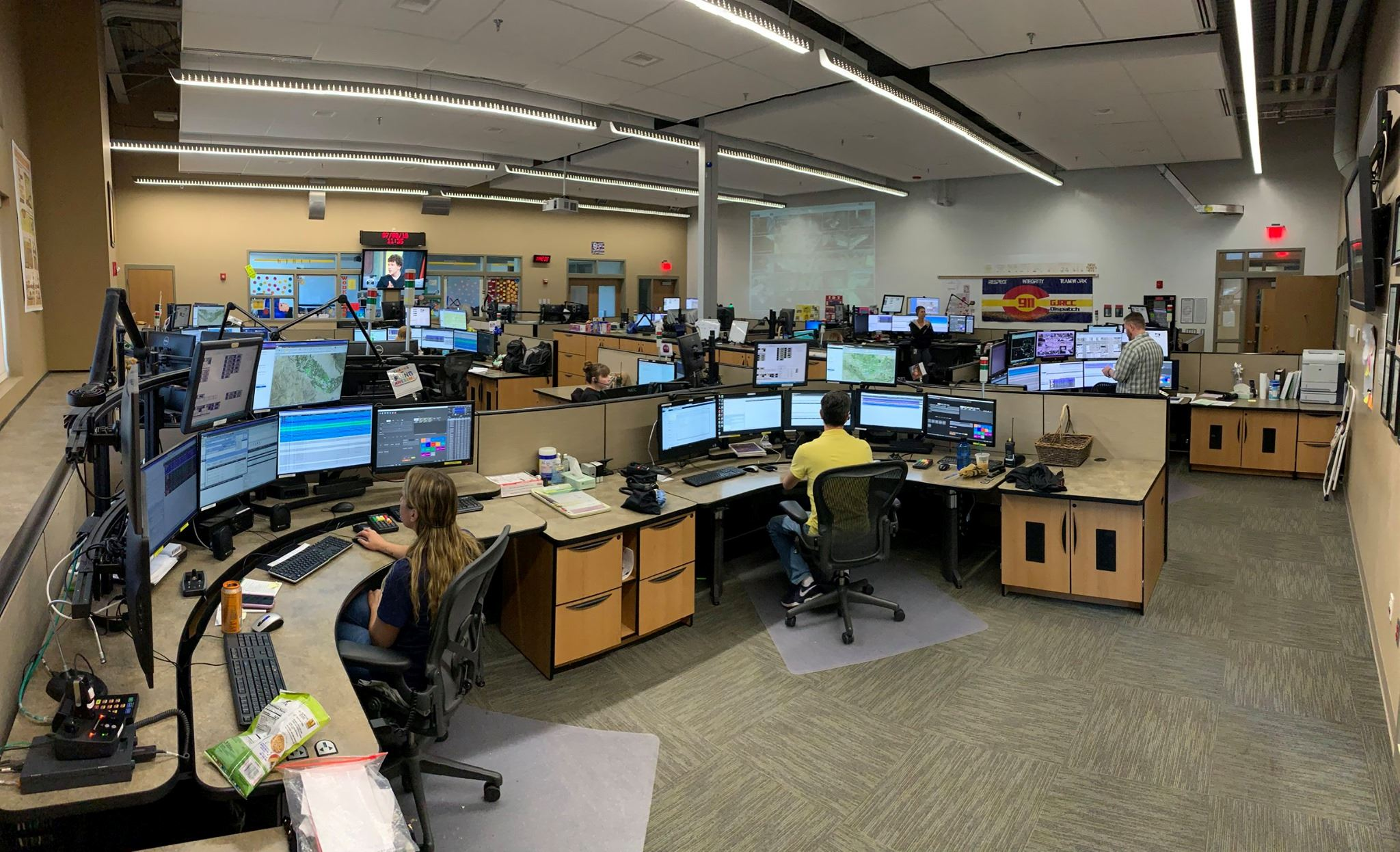 Image of our 911 dispatch center with personnel and equipment